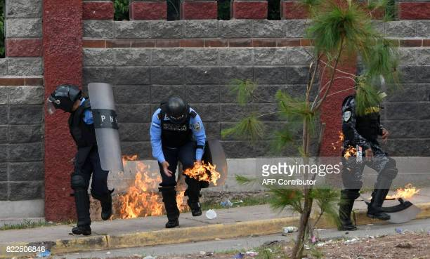 Riot police officers and a member of the Cobra Special Unit trying to disperse students of the National Autonomous University of Honduras gathered...