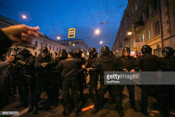 Riot police officers block a street during an unauthorized antiKremlin rally called by opposition leader Alexei Navalny who is serving a 20day jail...