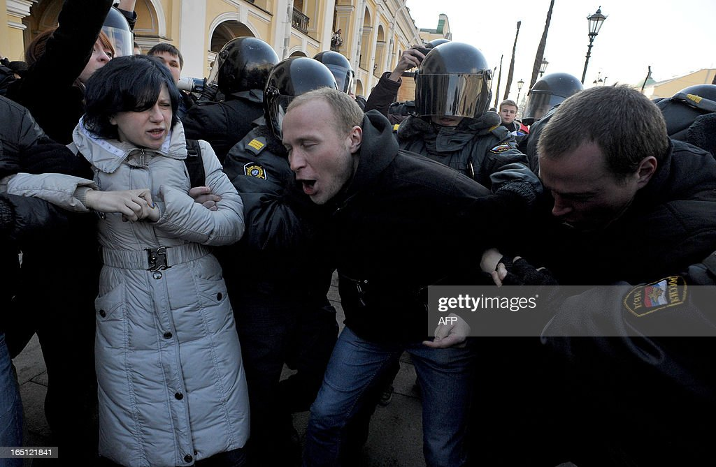 Riot police officers detain opposition activists in central St. Petersburg on March 31, 2013, during an unauthorized protest rally of opposition activists to defend the article 31 of the Russian constitution which guarantees freedom of assembly. Russian opposition activists call on authorities to respect the right to organize rallies every 31st of a month, which often leads to arrests by the police. AFP PHOTO / OLGA MALTSEVA