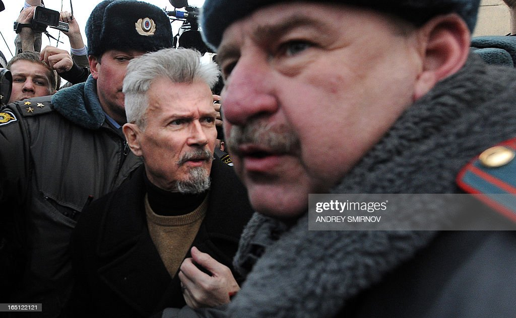 Riot police officers detain opposition leader, radical leftist leader and writer Eduard Limonov (2nd R) in central Moscow on March 31, 2013, during an unauthorized rally by opposition activists to defend Article 31 of the Russian constitution which guarantees freedom of assembly. Russian opposition activists call on authorities to respect the right to organize rallies every 31st of the month, which often leads to arrests by police. AFP PHOTO / ANDREY SMIRNOV