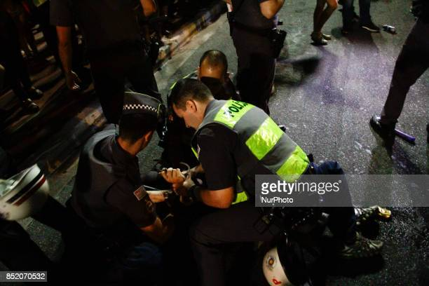 Riot police officers detain protesters during the protest against the decision of a Brazilian judge who approved gay conversion therapy in Sao Paulo...