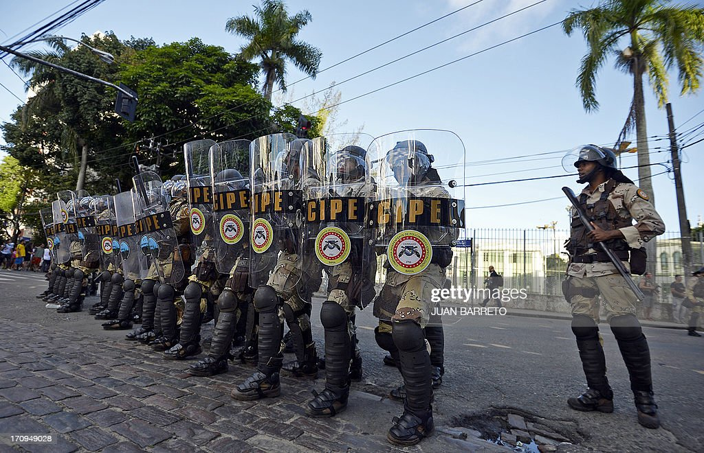 Riot police officers take their positions as protesters block an access to the Arena Fonte Nova Stadium in Salvador, Bahia --where Nigeria is to play Uruguay in a FIFA Confederations Cup Brazil 2013 football match-- during a protest of what is now called the 'Tropical Spring' against corruption and price hikes. Brazilians took to the streets again Thursday in several cities on a new day of mass nationwide protests, demanding better public services and bemoaning massive spending to stage the World Cup. More than one million people have pledged via social media networks to march in 80 cities across Brazil, as the two-week-old protest movement -- the biggest seen in the South American country in 20 years -- showed no sign of abating.