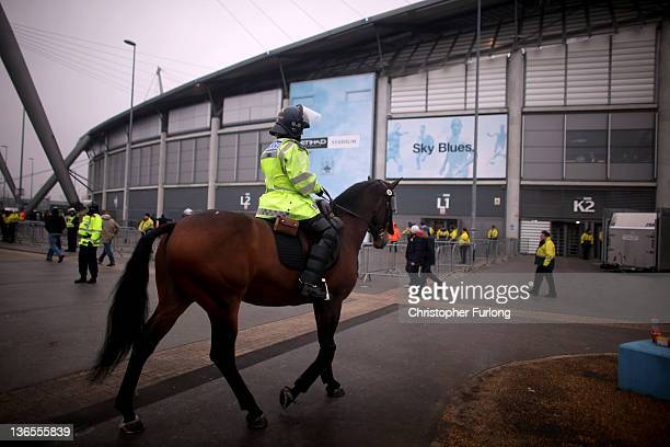 Riot police on horse stand guard before the FA Cup Third Round match between Manchester City and Manchester United at the Etihad Stadium on January 8...