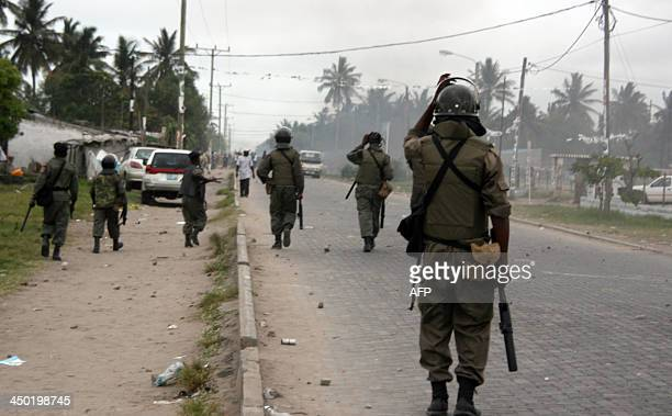 Riot police patrol on November 16 2013 in the central port city of Beira after clashes during the last stage of campaigning for the November 20...