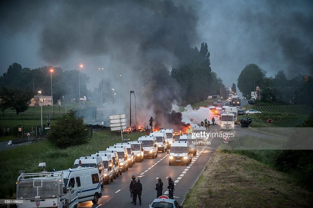 Riot police prepare to intervene to disperse refinery worker holding a blockade of the oil depot of Douchy-Les-Mines to protest against the government's proposed labour reforms, on May 25, 2016. Refinery workers stepped up strikes that threaten to paralyse France weeks ahead of the Euro 2016 tournament as the government moved to break their blockades, escalating a three-month tug-of-war over labour reforms.