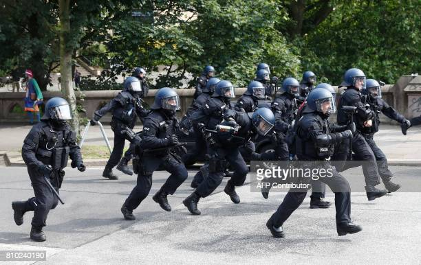 Riot police run against protesters on July 7 2017 in Hamburg northern Germany where leaders of the world's top economies gather for a G20 summit...