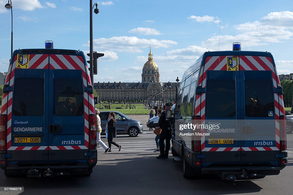 Riot police secure an area as Paris students demonstrate against the 'El Khomri' law project at Les Invalides on May 3, 2016 in Paris, France. After weeks of contestation and several demonstrations, French Minister of Labor, Employment and Social dialogue, Myriam El Khomri presented her text for the 'El Khomeri' labor law project' in front of the National Assembly.