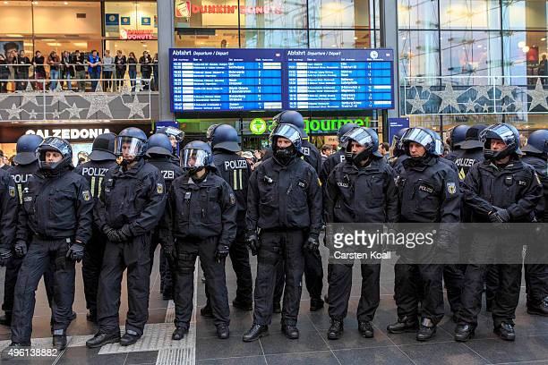 Riot police secure the train station as supporters of the Alternative fuer Deutschland political party protest at a rally in the city center on...