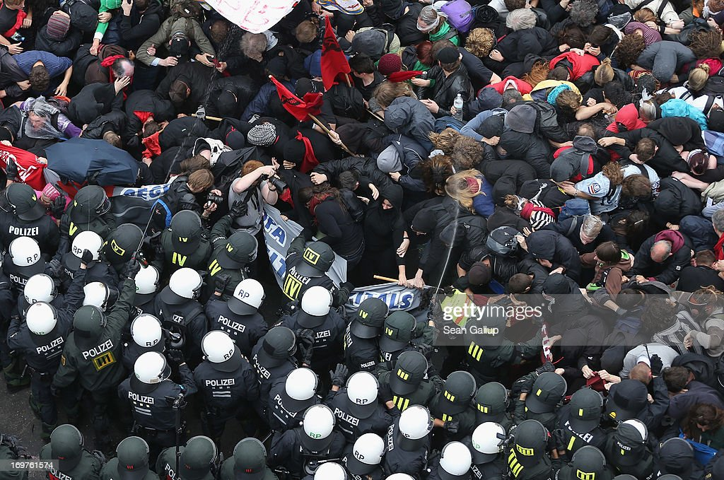 Riot police spray pepper spray into a crowd of protesters during the main Blockupy demonstration in the financial district on June 1, 2013 in Frankfurt am Main, Germany. Thousands of protesters are marching to demonstrate against capitalism, European Central Bank debt policy and the exploitation of textile workers in Third World countries, among other issues.
