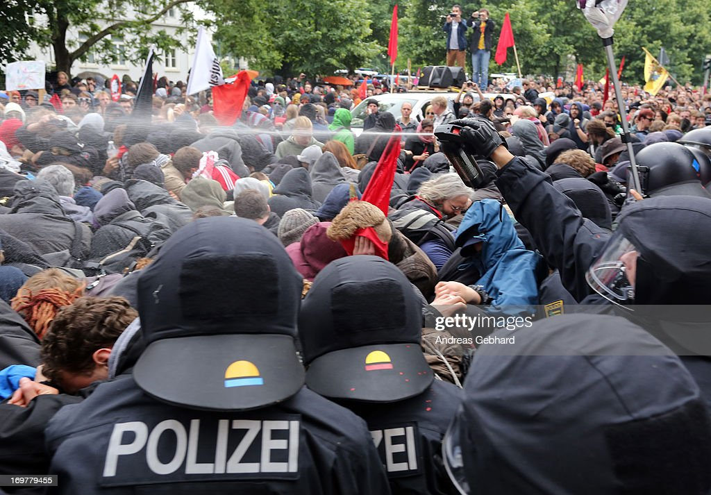 Riot police spray protesters with pepper spray during the main Blockupy demonstration in the financial district on June 1, 2013 in Frankfurt am Main, Germany. Thousands of protesters are marching to demonstrate against capitalism, European Central Bank debt policy and the exploitation of textile workers in Third World countries, among other issues.