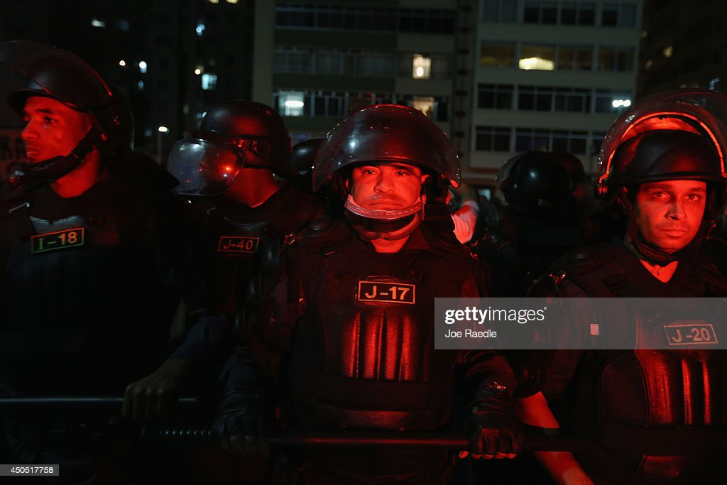 Riot police stand at the ready during an anti-World Cup protest march on Copacabana beach on June 12, 2014 in Rio de Janeiro, Brazil. Brazil defeated Croatia 3-1 in the first match of 2014 FIFA World Cup today.
