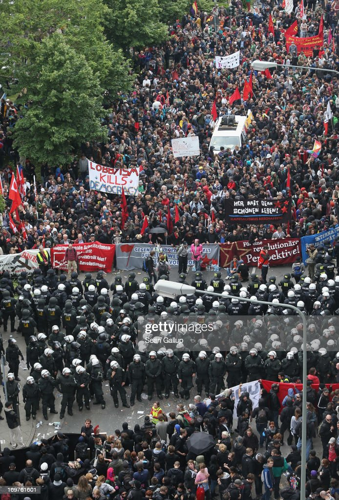 Riot police stand between groups of protesters during the main Blockupy demonstration in the financial district on June 1, 2013 in Frankfurt am Main, Germany. Thousands of protesters are marching to demonstrate against capitalism, European Central Bank debt policy and the exploitation of textile workers in Third World countries, among other issues.