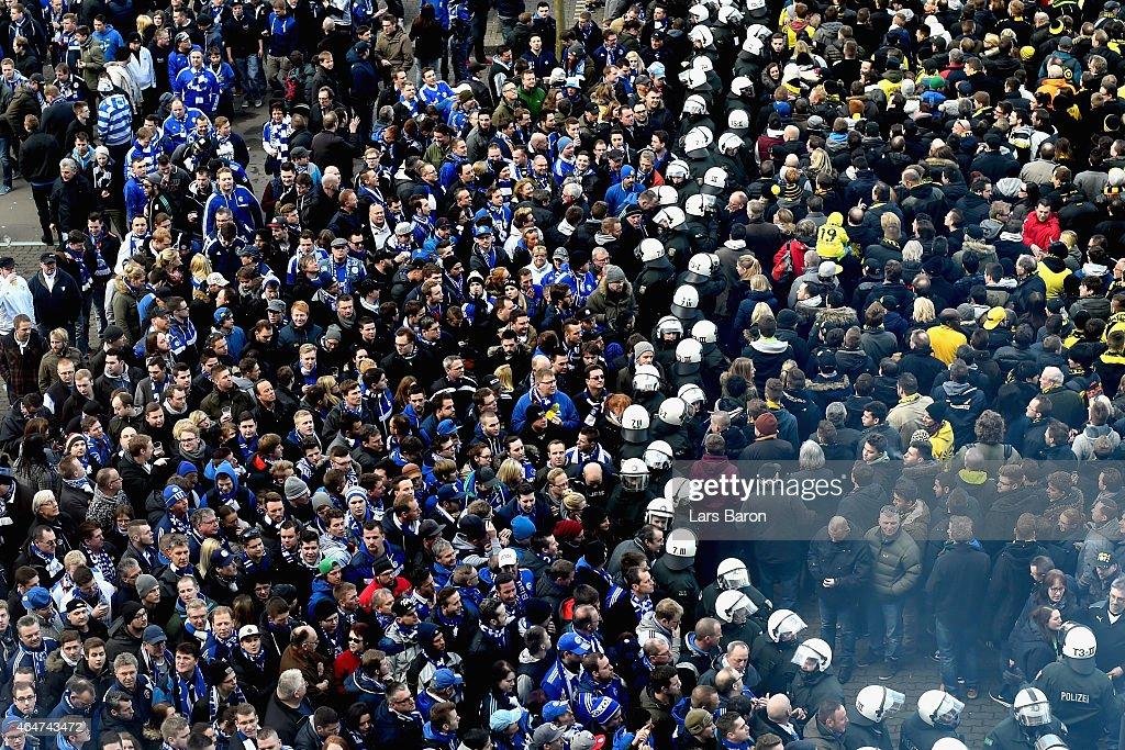 Riot police stand between supporters odf Dortmund and Schalke prior to the Bundesliga match between Borussia Dortmund and FC Schalke 04 at Signal...