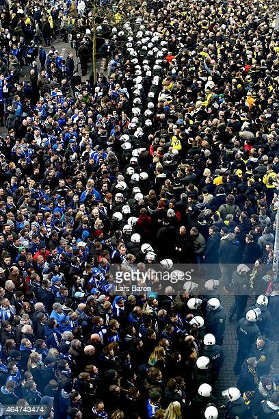 Riot police stand between supporters odf Dortmund and Schalke prior to the Bundesliga match between Borussia Dortmund and FC Schalke 04 at Signal...