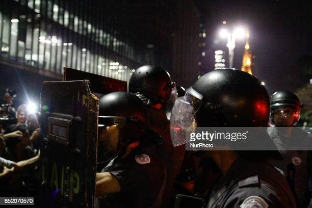 Riot police stand by as people protest against the decision of a Brazilian judge who approved gay conversion therapy in Sao Paulo Brazil on September...