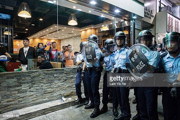 Riot police stand guard after clash with protesters at Mong Kok on November 25 2014 in Hong Kong The Mong Kok protest site is scheduled for clearance...
