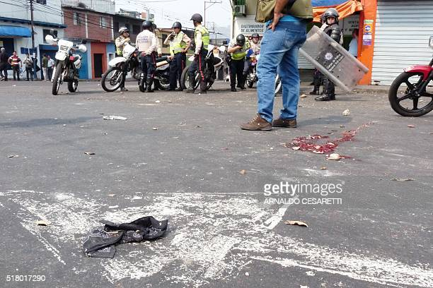 Riot police stand guard as students set up barricades during a protest against Venezuelan President Nicolas Maduro in San Cristobal Venezuela on...