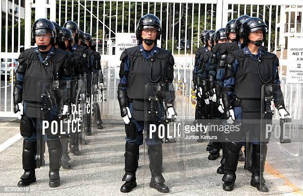 Riot police stand guard at the main gate of Yokosuka US Navy Base upon the arrival of USS George Washington on September 25 2008 in Yokosuka Kanagawa...