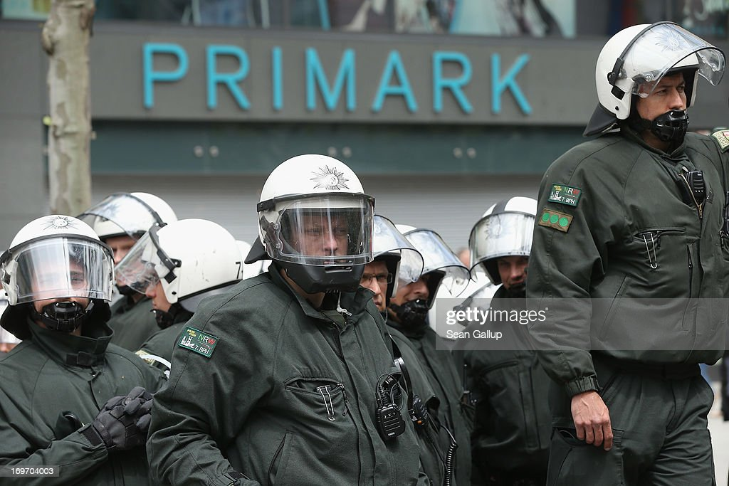 Riot police stand guard near a Primark discount clothing store during Blockupy protests in the Zeil pedestrian shopping street on May 31, 2013 in Frankfurt am Main, Germany. Several thousand protesters are taking part in Blockupy protests today and tomorrow in Frankfurt in order to demonstrate aginst ECB debt policy, food prices speculation by Deutsche Bank and the labor practices inherent in the discount clothing industry.