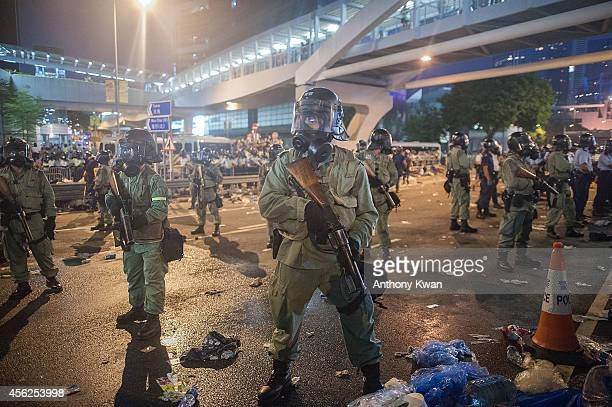 Riot police stand guard outside of Hong Kon Government Building on September 28 2014 in Hong Kong Thousands of people kicked off Occupy Central by...