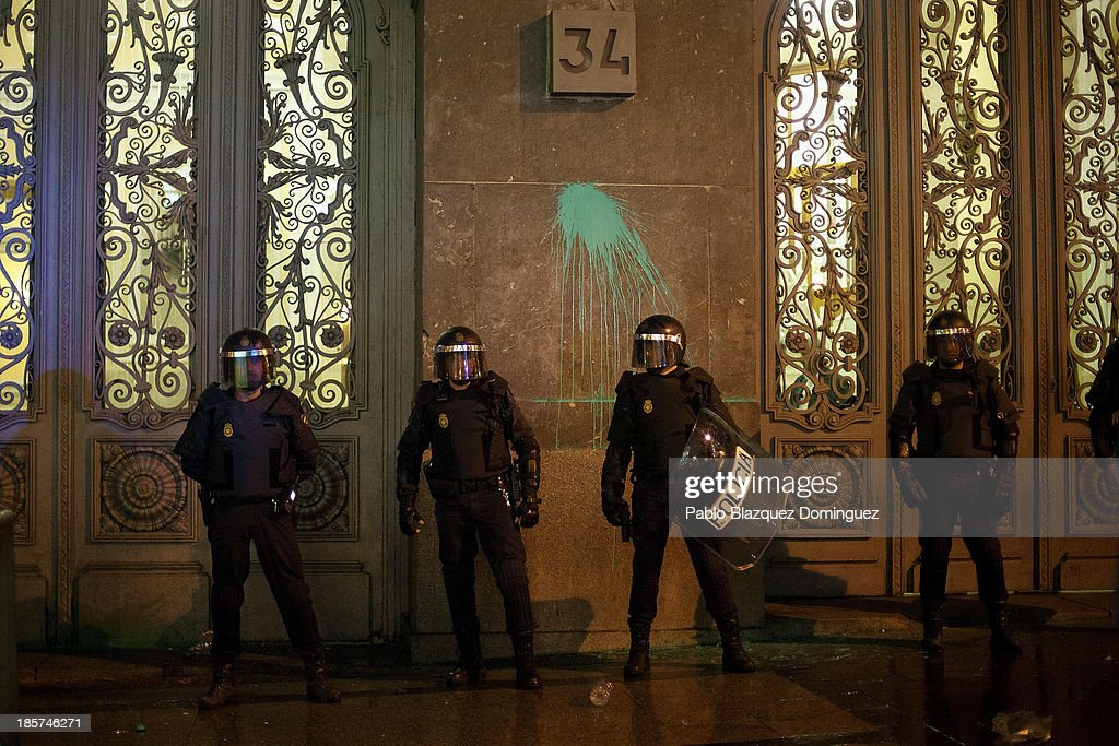 Riot police stand guard outside the Education Ministry during a demonstration at Alcala Street on October 24, 2013 in Madrid, Spain. The Spanish Parliament recently approved a controversial reform of the educational system, which passed by the ruling right wing People's Party (PP) using their absolute majority and not backed by any other political party. The students are on a three day strike to protest against the new law, which will need to be approved by the senate next month and are calling for the resignation of Education Minister, Jose Ignacio Wert.