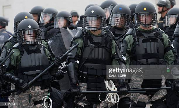 Riot police stand in a street during a demonstration against the G20 economic summit in Pittsburgh Pennsylvania September 24 2009 AFP PHOTO / Saul...