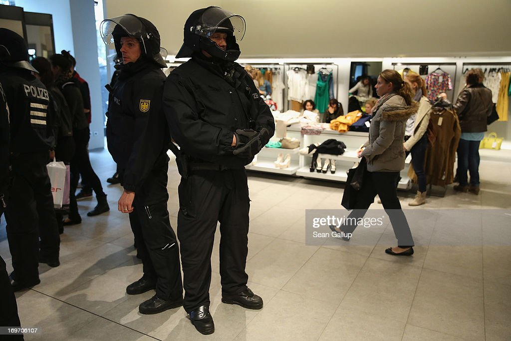 Riot police stand in a Zara clothing store after evicting Blockupy protesters in the Zeil pedestrian shopping street on May 31, 2013 in Frankfurt am Main, Germany. Several thousand protesters are taking part in Blockupy protests today and tomorrow in Frankfurt in order to demonstrate aginst ECB debt policy, food prices speculation by Deutsche Bank and the labor practices inherent in the discount clothing industry.