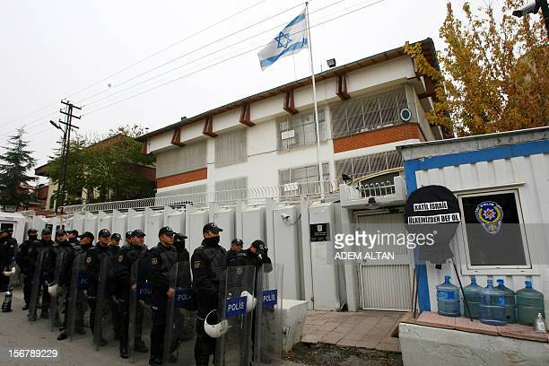 Riot police stand in formation as unseen Turkish protesters demonstrate against Israel's attack on Gaza outside the Israeli embassy in Ankara on...