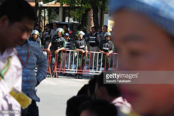 Riot police stand in line near the Court of Appeal to watch over a protest demanding the release of CNRP President Kem Sokha Kem Sokha was arrested...