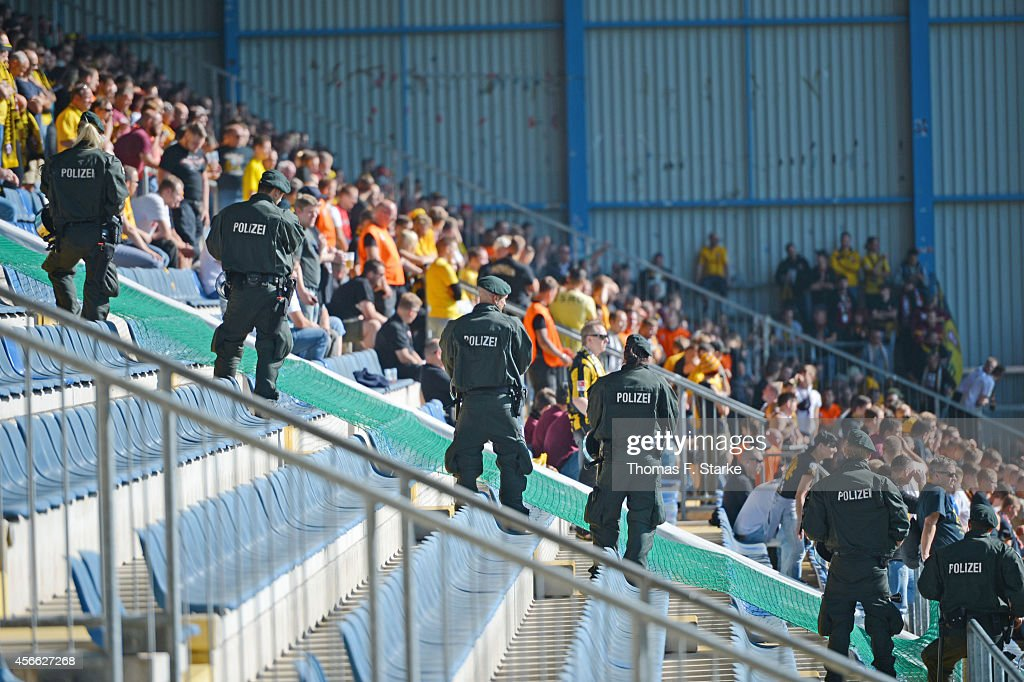 Riot police stand infont of the Dresden supporters sector during the Third League match between Arminia Bielefeld and Dynamo Dresden at Schueco Arena...