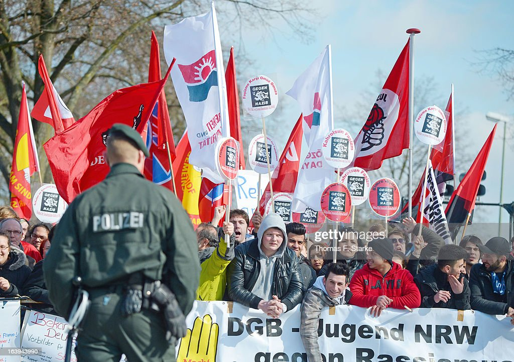 Riot police stand infront of counter demonstrators after a protester hit Joerg Ueckermann, Deputy Chairman of the anti-Islam Pro-NRW group, in the face with an egg while Ueckermann was speaking during a Pro-NRW rally on March 18, 2013 in Bielefeld, Germany. Nine Pro-NRW members held the rally and were booed down by 700 counter-demonstrators. Pro-NRW, based primarily in western Germany and Berlin, has sought a strongly anti-Islam agenda and demonstrates frequently against the construction of mosques in Germany. Police recently arrested several radical Salafite Islam members in Germany who were planning to assassinate Pro-NRW leader Markus Beisicht.