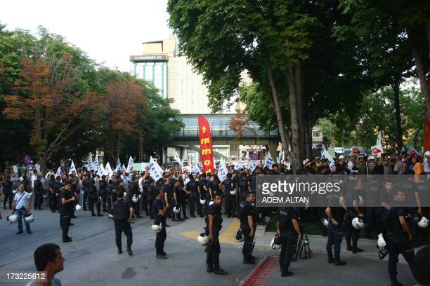 Riot police stand near the office of prime minister Recep Tayyip Erdogan as members of Turkey's Union of Chambers of Architects and Engineers march...
