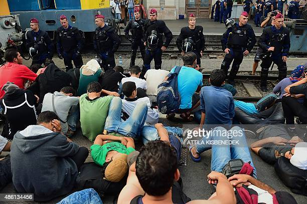 Riot police stand on the train track as they monitor migrants and refugees at the Keleti railway station in Budapest on September 1 2015 Keleti the...