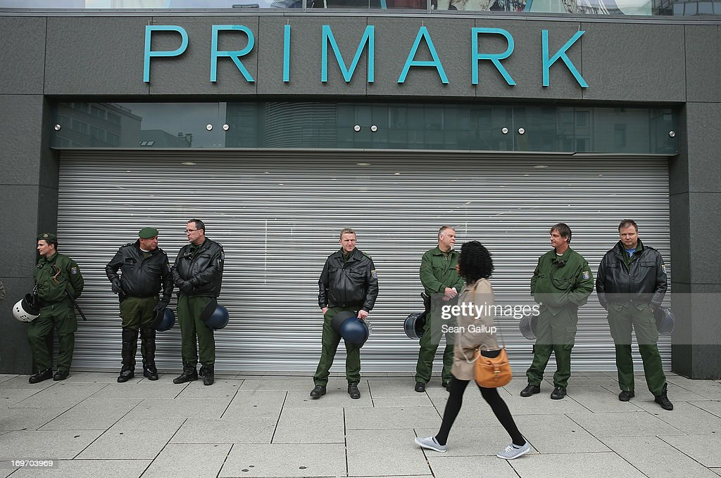 Riot police stand outside a Primark discount clothing store during Blockupy protests in the Zeil pedestrian shopping street on May 31, 2013 in Frankfurt am Main, Germany. Several thousand protesters are taking part in Blockupy protests today and tomorrow in Frankfurt in order to demonstrate aginst ECB debt policy, food prices speculation by Deutsche Bank and the labor practices inherent in the discount clothing industry.