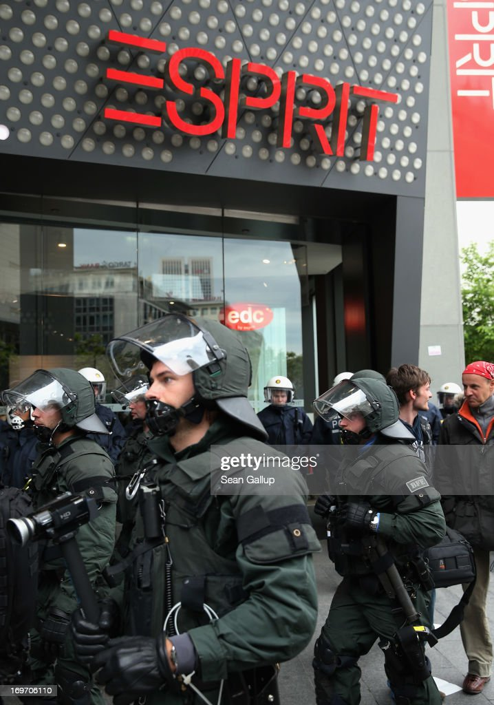 Riot police stand outside an Esprit clothing store after evicting Blockupy protesters in the Zeil pedestrian shopping street on May 31, 2013 in Frankfurt am Main, Germany. Several thousand protesters are taking part in Blockupy protests today and tomorrow in Frankfurt in order to demonstrate aginst ECB debt policy, food prices speculation by Deutsche Bank and the labor practices inherent in the discount clothing industry.