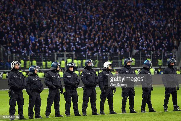 Riot police stands on the pitch after the Bundesliga match between Eintracht Frankfurt and SV Darmstadt 98 at CommerzbankArena on December 6 2015 in...