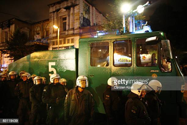 Riot police stay in front of a water canon at the left wing center named Rote Flora on October 3 2008 in Hamburg Germany During the day protestors...