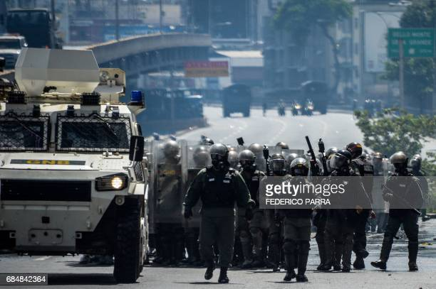 Riot police take position as Venezuelan opposition activists hold a rally against the government of President Nicolas Maduro in Caracas on May 18...