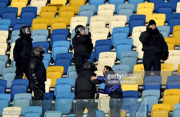 Riot police try to disperse Besiktas supporters after the UEFA Champions League football match between FC Dynamo Kyiv and Besiktas at the Olympiyski...