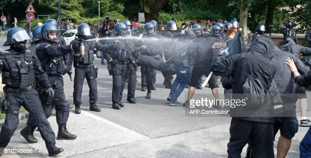 Riot police use pepper spray against protesters on July 7 2017 in Hamburg northern Germany where leaders of the world's top economies gather for a...