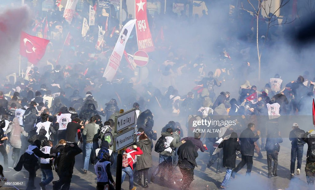 Riot police use tear gas and a water cannon to disperse protesters as they try to march to the parliament building in Ankara during a demonstration against the Turkish prime minister and Turkey's ruling Justice and Development Party (AKP) on February 13, 2014. Turkish riot police on February 13 fired tear gas and water cannon at around 2,000 protesters demanding the release of army officers jailed for plotting a coup. At least 12 protesters were arrested and two people, including a police officer, were injured in clashes.