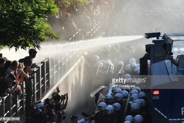 Riot police use water cannon during the 'Welcome to Hell' rally against the G20 summit in Hamburg northern Germany on July 6 2017 Leaders of the...