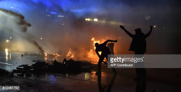 Riot police use water cannon on July 7 2017 in Hamburg northern Germany where leaders of the world's top economies gather for a G20 summit Protesters...