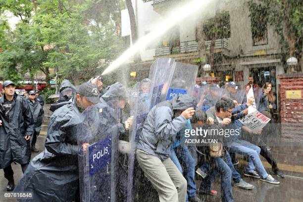 TOPSHOT Riot police use water cannon to disperse protesters demonstrating in support of two hungerstrikers who were taken into custody in May in the...