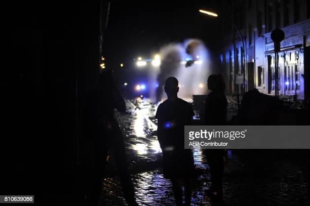 Riot police use water cannons during protests in Hamburg's Schanzenviertel district on July 7 2017 in Hamburg northern Germany where leaders of the...