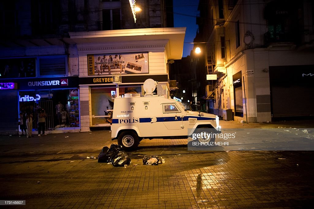 A riot police vehicle patrols during a protest in Istiklal avenue in Istanbul on July 8, 2013. Turkish riot police fired rubber bullets, tear gas and water cannon to block demonstrators from entering a small Istanbul park, the birthplace of deadly unrest that engulfed the country last month. AFP PHOTO/BEHROUZ MEHRI