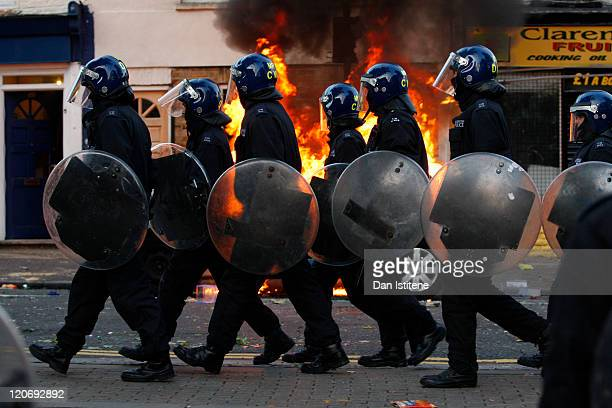 Riot police walk along Clarence Road in Hackney on August 8 2011 in London England Pockets of rioting and looting continues to take place in various...