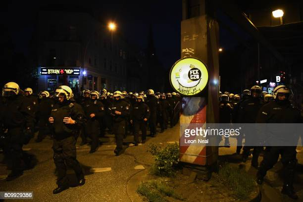 Riot police walk down a road after the 'Welcome to Hell' protest march on July 6 2017 in Hamburg Germany Leaders of the G20 group of nations are...