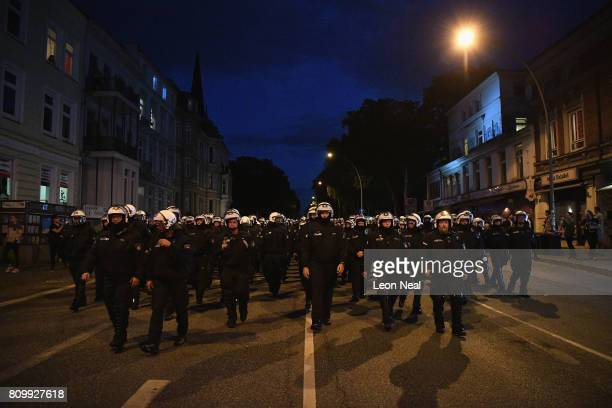 Riot police walk down a road during the 'Welcome to Hell' protest march on July 6 2017 in Hamburg Germany Leaders of the G20 group of nations are...
