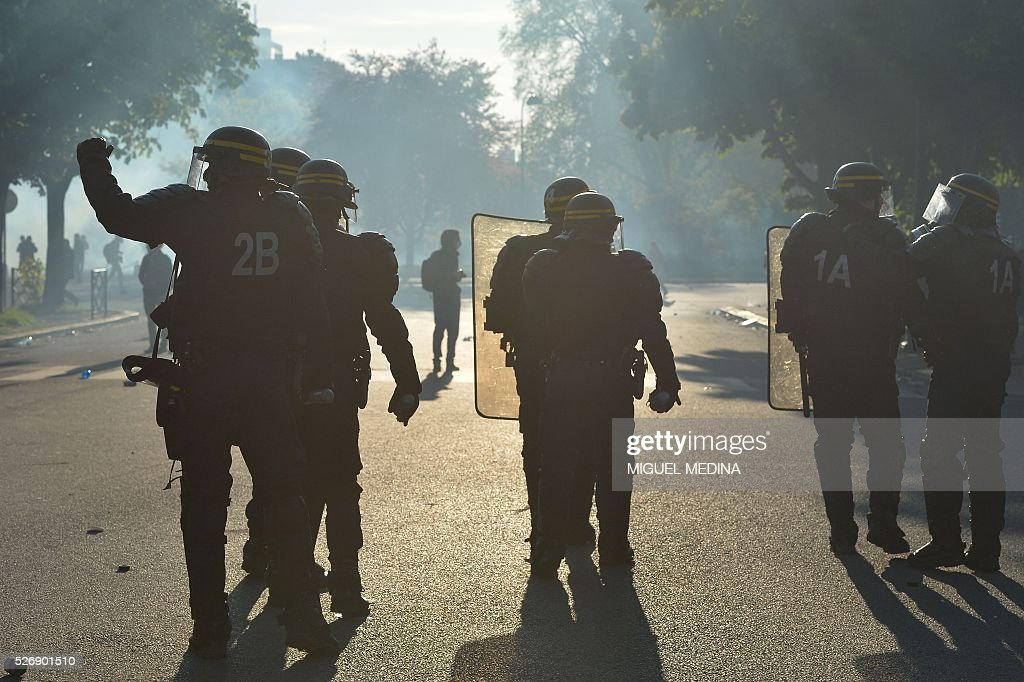 Riot police walk in a group during clashe with protesters at a traditional May Day demonstration on May 1, 2016, in Paris.